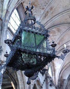 Lantern in wrought iron museum - look at the gorgeous ribbed arch stone ceiling behind the lantern