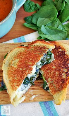 Spinach Artichoke Grilled Cheese | by Life Tastes Good is the classic dip in sandwich form and totally tasty! This Grilled Cheese sandwich is loaded with fresh spinach, artichokes, and lots of ooey gooey, melty cheese! It's a classic flavor combo, and I'm excited to share it with you in this tasty sandwich recipe! #SundaySupper