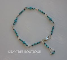 Tiny seed beads in turquoise and navy combined with Swarovski crystals by Baytree Boutique