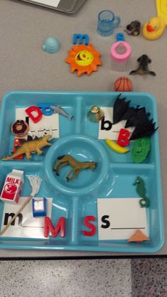 beginning sound sort, chip & dip tray from dollar tree and lakeshore letter tubs.