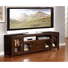 Keep your media items organized with the help of this stylish 72-inch media console with central drawers. Finished in a warm coffee brown, this convenient urban console features tempered glass side doors for storing DVDs, games, movies and other items.