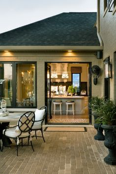 kitchen opening onto outdoor dining area - designed by Joy Tribout