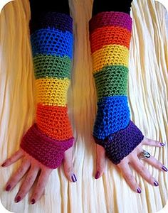 Bright rainbow arm warmers! My little knitter could make these
