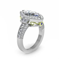Marquise Shape Center Diamond, Round Brilliant Cut Diamond Halo and Shank, with Princess Cut Diamond and Blue Sapphire Accents.