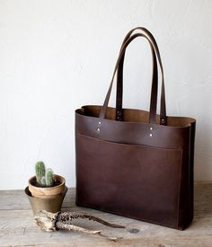 f55623a6834b Dark Brown premium distressed leather, sturdy and matte high quality  genuine Italian leather. Bag