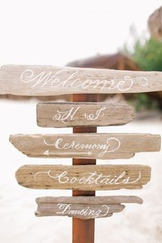 using driftwood for your beach wedding, here they have created  signage to get you to the church on time. just be creative, for your beach or seaside event. driftwood is perfect.............