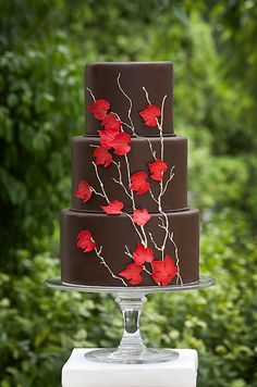 A Three-Tier Brown Wedding Cake with Red Leaves. This chocolate fondant AP Signature Cakes creation gets a fall wedding-worthy touch from the gold piped branches and red sugar maple leaves. Brown Wedding Cakes, Pretty Wedding Cakes, Fall Wedding Cakes, Pretty Cakes, Autumn Wedding, Chocolate Wedding Cakes, Red Wedding, Summer Wedding, Wedding Ideas