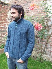 A rustic man's sweater with a button neckline.