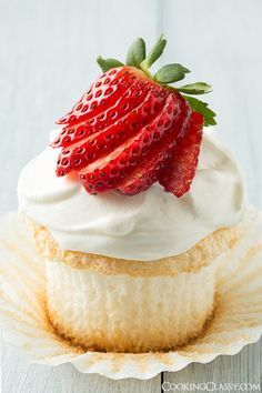 Angel Food Cupcakes - with a cream cheese whipped cream topping and fresh strawberries. This looks amazing