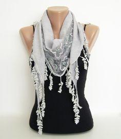 Light scarf over dark shirt