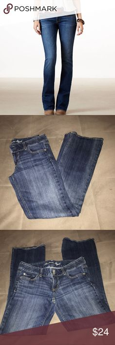 AEO Artist Dark Rinse Distressed Jeans Super cute and stretchy Artist style jeans from AEO. Mid rise boot cut style. Great all around Jeans. Excellent quality and condition. Check out my other listings to bundle and save 25% 😎! American Eagle Outfitters Jeans Boot Cut