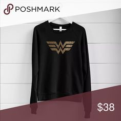 """WONDER WOMAN Glitter Sweatshirt WONDER WOMAN Glitter Sweatshirt.  Cute fan Sweatshirt! Ladies Fashion Top (not unisex fit) Black, 60% Cotton 40% Polyester SIZE XXL, Ladies (runs small)  25"""" (underarm to underarm) 25"""" Length  Approximate measurements taken with shirt laid flat. Only size XXL available. Custom top, no brand. Tops Sweatshirts & Hoodies"""