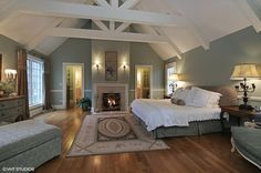 Can't get enough of this vaulted ceiling in this master suite complete with fireplace