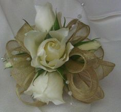 white roses and gold ribbon