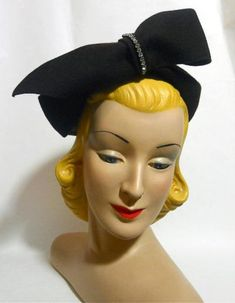 1930s sculpted oversize bow felt hat in dark brown with rhinestone accent.  Via Dorothea's Closet Vintage.