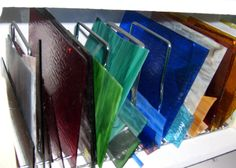 Create glass storing area with glass exposed to easily access/see colors to work with, easily grab.