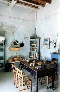 a simpler place. love the light jade fescoed walls and turquoise shabby-chic doorless cupboard