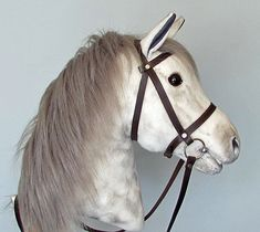 Hobby Horse with open mouth. Dapple grey hobby horsing horse (stick horse). Leather bridle with bit.For older children and teenagers.