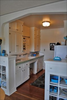 This tiny kitchen is in an old apartment building in a very small studio apartment. This was a common design in 1920s Portland apartments. - glass door hutches
