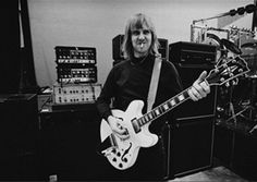 Alex Lifeson, guitarist with Canadian rock band Rush, smoking a cigarette as he… Great Bands, Cool Bands, Rush Music, Rush Concert, A Farewell To Kings, Rush Band, Alex Lifeson, Neil Peart, Greatest Rock Bands