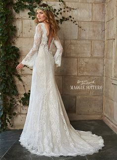 Romantic bohemian wedding dress with lace sleeves and a deep v back, Dahlia by Desiree Hartsock with Maggie Sottero.