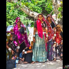Rajasthani women gather in the shade of some trees as they wait their turn to bathe in Pushkar Lake in Rajasthan. Located in Ajmer district, Pushkar Lake is a sacred lake of the Hindus. #India #Rajasthan #travelphotography #wanderlust #TheMemoryWeaver