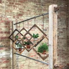 43 Charming Outdoor Hanging Planters Ideas to Brighten Your Yard The back porch is a superb place to Garden Planters, Garden Art, Garden Design, Hanging Planters Outdoor, Planter Pots, Outdoor Wall Art, Garden Soil, Diy Hanging, Succulent Wall Art
