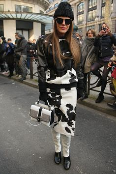 A luxe sweatshirt, animal print, hide AND a skirt over skinny pants, @AnnaDelloRusso nails 4 top trends at once! #StreetStyle #PFW  WGSN Street Shot, Paris Fashion Week