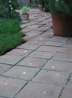 Fiber optic pathway. The DIY process can be simplified by simply adding the lights in between the stones, therefore saving the labor of drilling endless holes in stone.