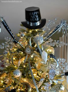 Tree decorated to ring in the new year with a hat tree topper, party horns, tiaras and confetti streaming ribbon | homeiswheretheboatis.net #party #newyear