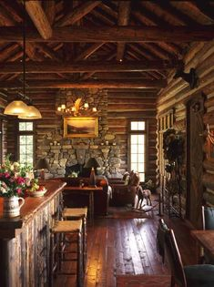 A charming, rustic kitchen and living area with exposed wooden beams and stone creates a welcoming environment in this lodge home.