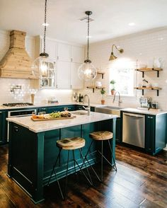 show this to folks for inspo. Our kitchen will look like this with black floors, chop block counter tops, floating shelves, and a cool vent hood thing.