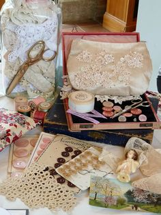 Old sewing collectibles titled Sunday by found and sewn, via Flickr