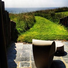 View from the terrace of a room over the garden to the sea beyond