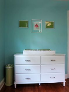 Maybe the TYSSEDAL as a changing table. not too wide, but wide enough for a basket/caddy of creams, extra diapers, etc.