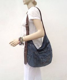 Handmade denim slouchy hobo cross body bag. Rock, Grunge, Boho, Street style, Urban fashion.  Made out of a pair of jeans! So, each of the bags has a lot of character and always is unique, one of a kind item.  This one is made of nice jeans in dark dirty color.  Brown canvas handle. Three functional pockets outside. Printed cotton lining. Zippered closure. Inside there is a zipped pocket.  Machine washable.  Made of recycled denim. I do my bit to save the Planet :) Always prewashed jeans and…