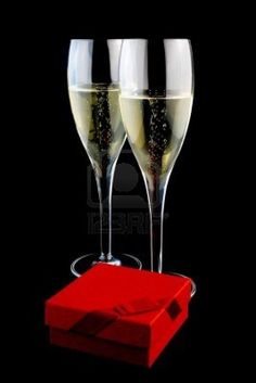 two glass with champagne near a gift on a black background Stock Photo