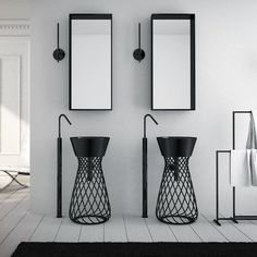 Freestanding wire basin by art ceramic. The freestanding wire basin comes in either black or white. ➤To see more Luxury Bathroom ideas visit us at www.luxurybathrooms.eu #luxurybathrooms #homedecorideas #bathroomideas @BathroomsLuxury