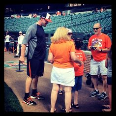 Orioles catcher Matt Wieters with fans during batting practice.  Look at how tall this guy is!!