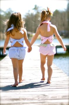 This kinda reminds me of me and Sunni when we were little with the matching bathing suits and hairstyles (: