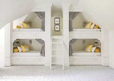 Walsh designed custom bunks -- one for each of the family's four children -- that are accessible to each other via cut-outs in the wall. Each features a shelf for personal belongings and a nautical-inspired sconce by Circa Lighting. The graphic carpet is by David Hicks. | Home At Last | At Home in Arkansas | August 2016 | @bearhillint