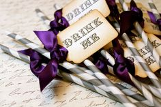 Drink me straws in purple, grey, and white. Fun for an Alice in Wonderland themed candy buffet.