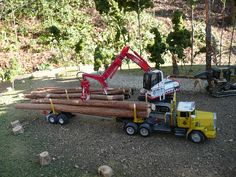 Outdoor shot of the Mack RM-600, Linkbelt log loader,and D5 Cat skid dozer...