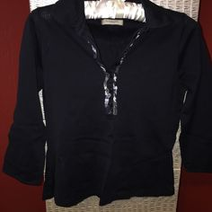 Burberry 3/4 Sleeve Black Top Authentic Burberry 3/4 length sleeve black top. Shirt has grey Burberry check pattern on v-neck. Top hits at waist. Size tag is missing but it is a size small (I compared it to another Burberry shirt that is the same style). The tag inside the shirt towards the bottom has also been removed (the one telling the material & how to wash). I purchased this at Neiman Marcus. If you have any questions, please ask! Burberry Tops