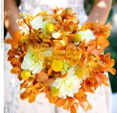 love this bouquet. it's got amazing texture and flowers. I think those are orchids, billy bob's and carnations or daisies?