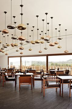 Wine tasting room at Hotel L'AND Resort in Évora, Alentejo, Portugal by Marcio Kogan, Void pendant Tom Dixon Hotels In Portugal, Hotel Restaurant, Restaurant Design, Design Hotel, Commercial Design, Commercial Interiors, Best Interior, Interior And Exterior, Modern Restaurant