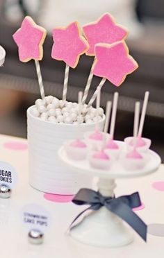Pink frosting and edible glitter -- does it get more girly than that? | How to Plan a Princess Party - Parenting.com