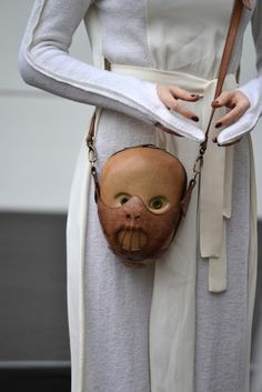 Hannibal Lecter purse  I dont know which is creepier, The outfit or the purse?