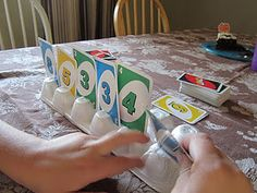 We can always use more card holders for card games. I never thought of using egg cartons before.