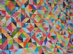 Beautiful giant quilt made with brightly coloured patterned fabrics @ Don't Call Me Betsy http://dontcallmebetsy.blogspot.com/